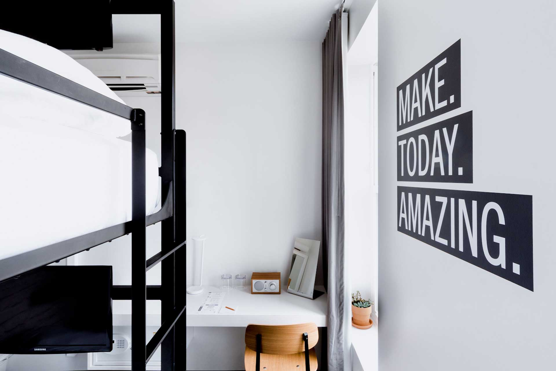 room with bunk beds and desk