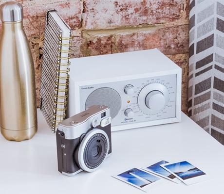 camera, water bottle, clock radio